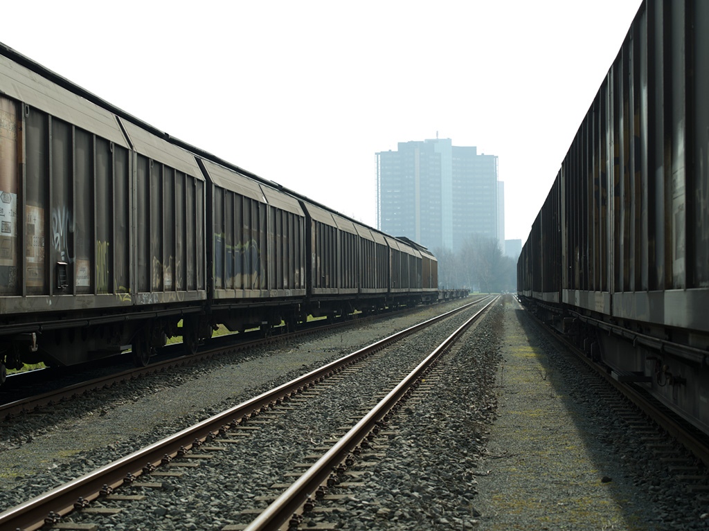 Two freight trains and an empty track
